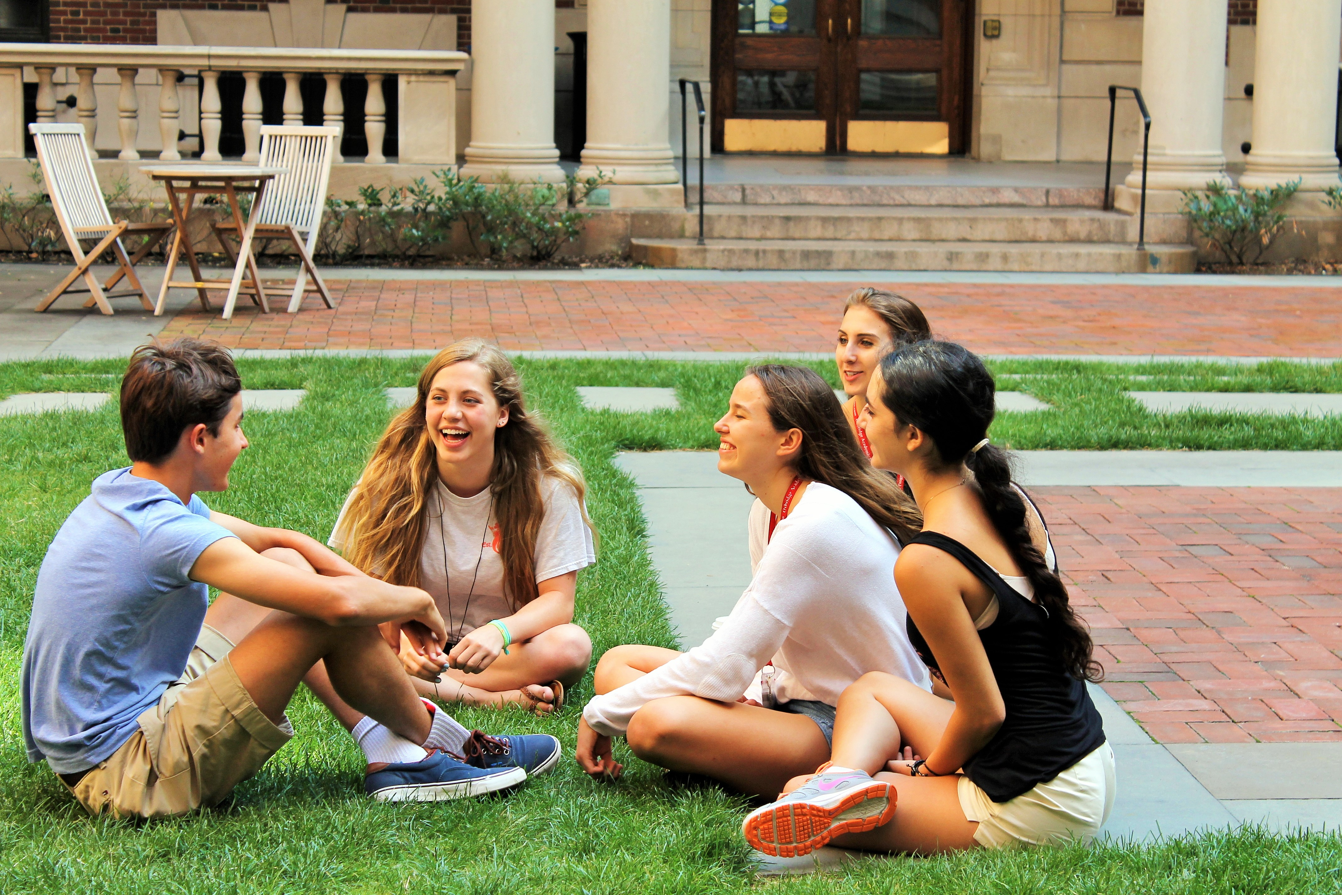 Oxbridge students share their academic success stories while outdoors on campus grounds