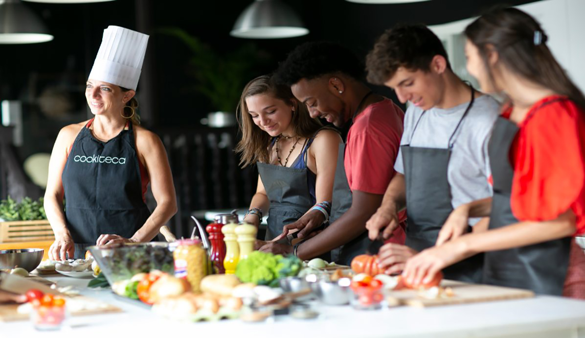 Students during summer course cook with professional chef