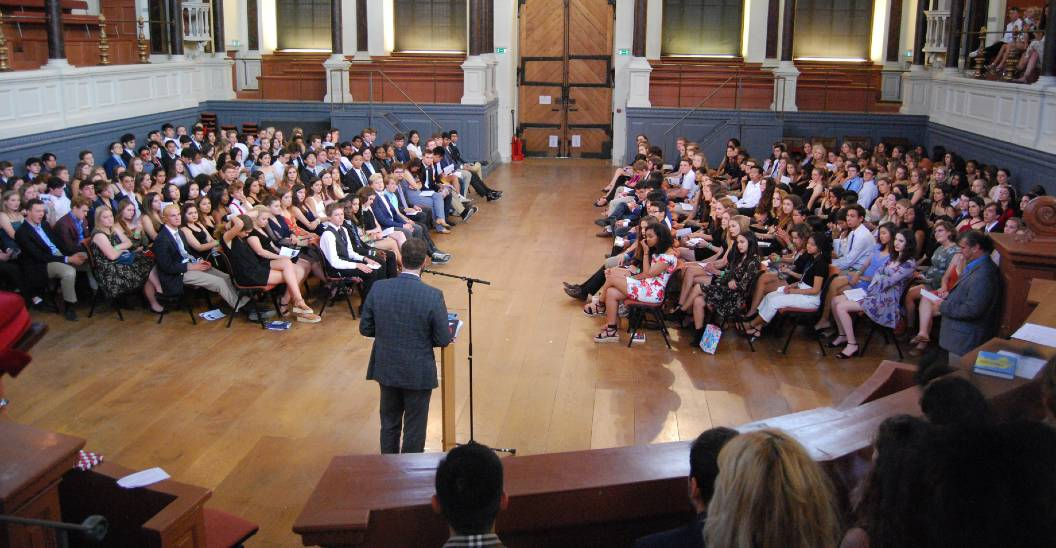 Oxbridge students sit for lecture during Oxbridge in Boston