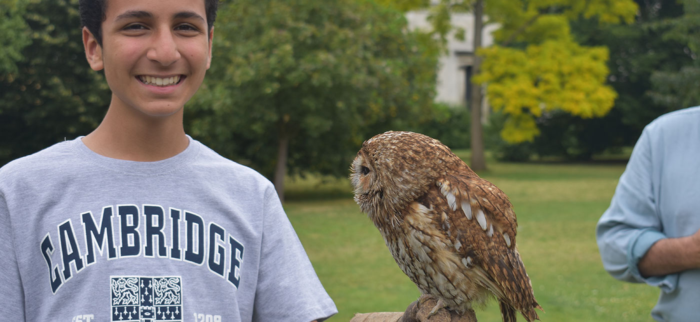 Student engaged with birds of prey at Cambridge