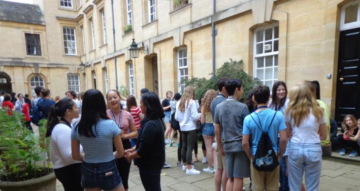 Oxbridge students gathered in front of Corpus Christi College in Oxford