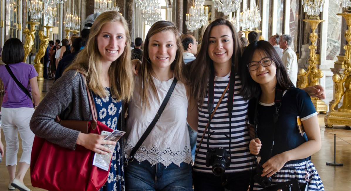 students enjoy a visit to a historic museum in Paris with Oxbridge